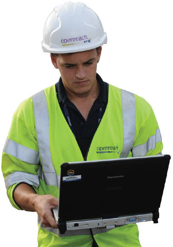 An OpenReach workman in protective clothing using a laptop on site