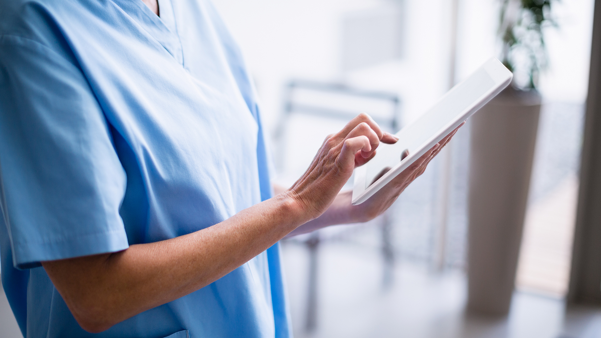 Image of a nurse with digital device